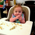 A more recent photo of her feeding herself broccoli-cauliflower-quinoa bites, and loving it.